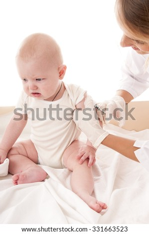 Doctor makes vaccination the child on white background.
