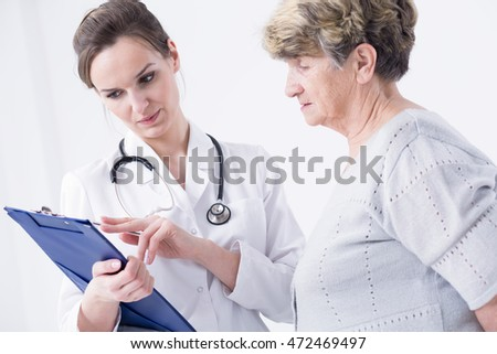 Doctor making the anamnesis with the senior lady patient