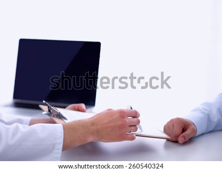 Doctor male giving patient folder with  paper in her office, isolated - stock photo