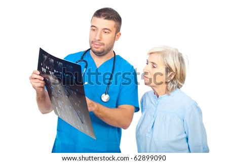 Doctor man showing and explaining his patient senior woman  the MRI scans results