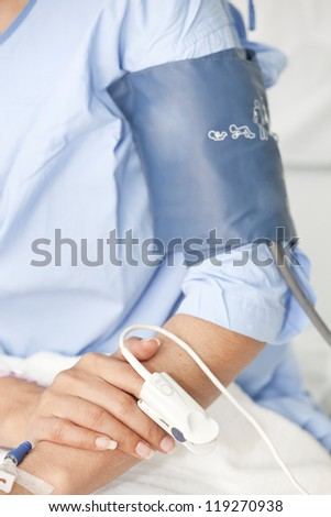 Doctor measuring blood pressure - stock photo