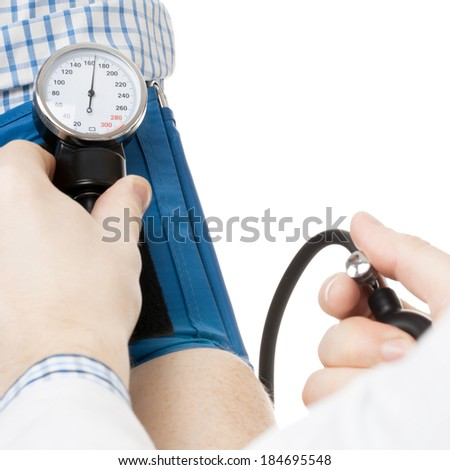 Doctor measuring patients blood pressure - studio shoot - 1 to 1 ratio - stock photo