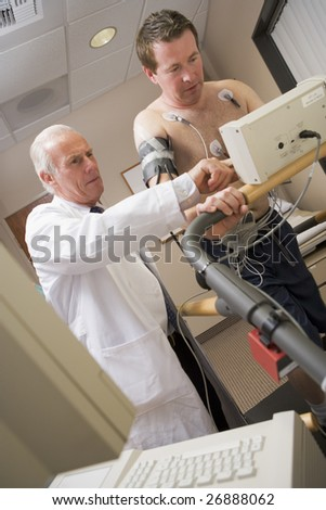Doctor Monitoring Patient During Health Check - stock photo
