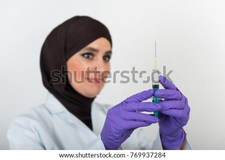 Doctor Muslim Islamic women on white background with injection