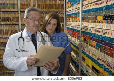 Doctor nurse health care professional - stock photo