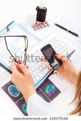 Doctor, nurse taking a phone and calling to patient - stock photo