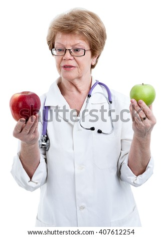 Doctor nutritionist looking at red big apple in one hand and holding green apple in other isolated on white background