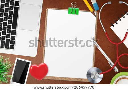 doctor office desk with blank clipboard - stock photo