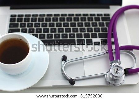 Doctor office,Top view ,Laptop with cup of coffee - stock photo