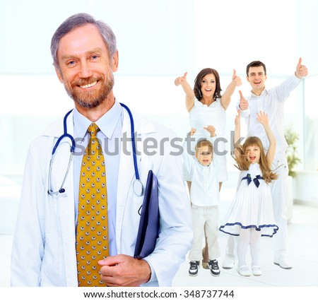 Doctor on the background of the happy family - stock photo