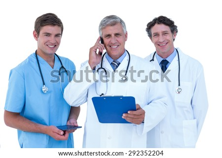 Doctor on the phone holding a clipboard on a white background