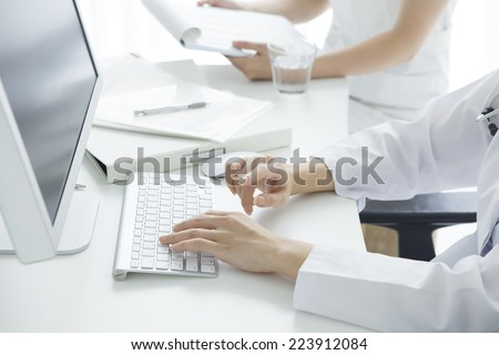 Doctor operating the computer - stock photo
