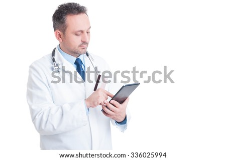 Doctor or medic using credit  card and wireless tablet  as online medical services secure payment concept - stock photo