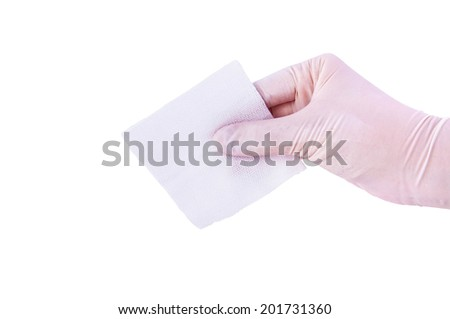 Doctor or Nurse Hand with Medical Gloves Holding Clean Gauze for concept and idea of Surgery First-Aid care for patients, Medical Tool and Surgery Instrument, Isolated on white. - stock photo