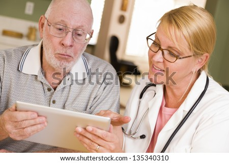 Doctor or Nurse Talking to Senior Man with Touch Pad Computer. - stock photo