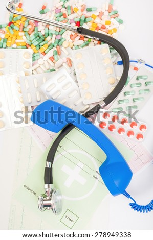 Doctor or pharmacy support or assistance concept with pills, medical prescription and stethoscope - stock photo