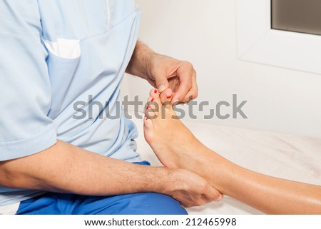 Doctor orthopedist  make examination of the foot in his office - stock photo