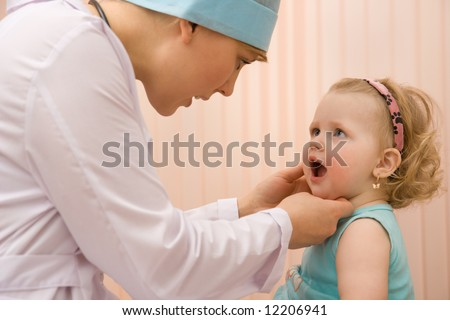 Doctor pediatrician exam baby mouth  Close-up - stock photo