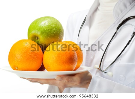 Doctor prescribing healthy eating: closeup of doctor's hands holding plate with fresh fruits; isolated on white background - stock photo