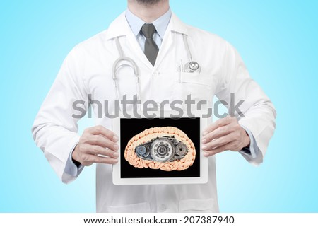doctor presenting diagnosis propulsion with gear in the head of a brain in digital tablet screen concept for medical for creative thinking - stock photo