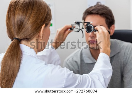 Doctor putting special lenses - stock photo