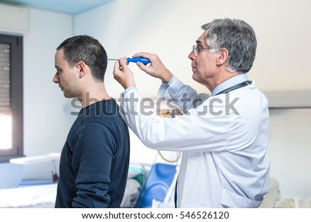 Doctor repairing the brain of a patient