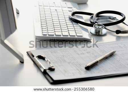 Doctor's desk in evening with no person - stock photo