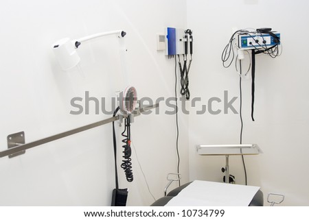 doctor's examination room with equipment - stock photo