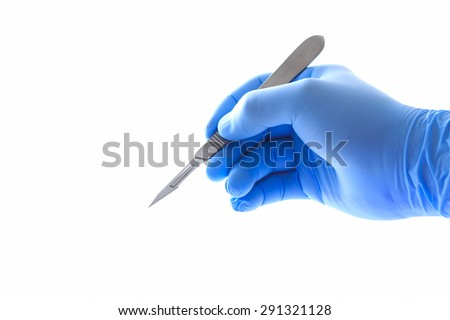Doctor's hand holding a scalpel with clipping path - stock photo