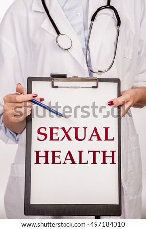 Doctor's hands shows the word sexual health. Medical concept.