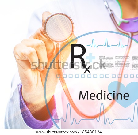 doctor's hands with stethoscope - stock photo