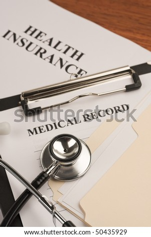 Doctor's stethoscope, medical record and health insurance document. Concept of healthcare. - stock photo