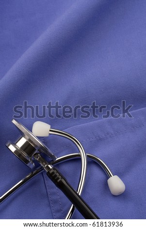 Doctor's stethoscope on scrubs.  Concept of healthcare or medical. - stock photo