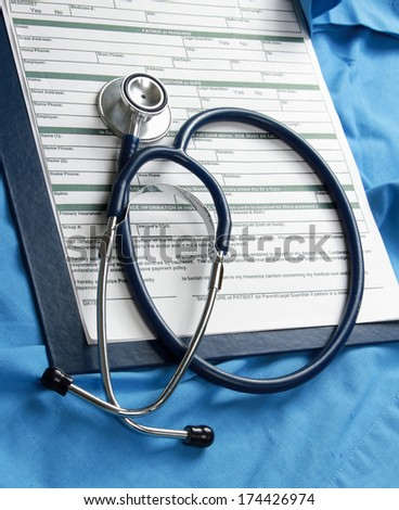 Doctor's stethoscope on the form - stock photo