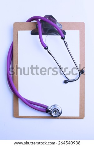 Doctor's stethoscope  with folder on the desk - stock photo