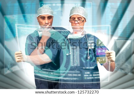Doctor's team in uniform with X-rays and digital  screens - stock photo