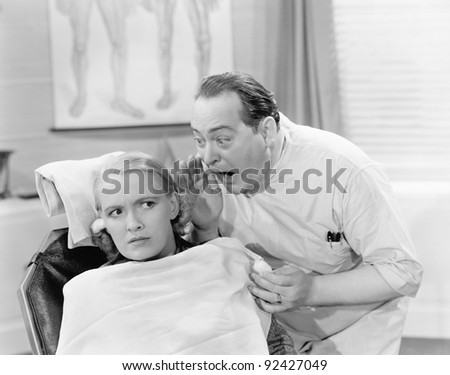 Doctor shouting into the ear of a patient