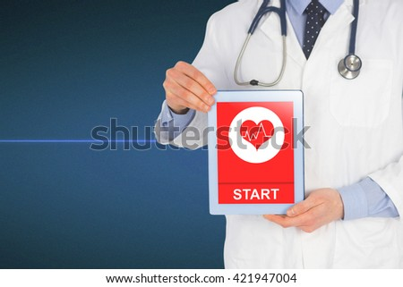 Doctor showing a digital tablet against view of heart beat - stock photo
