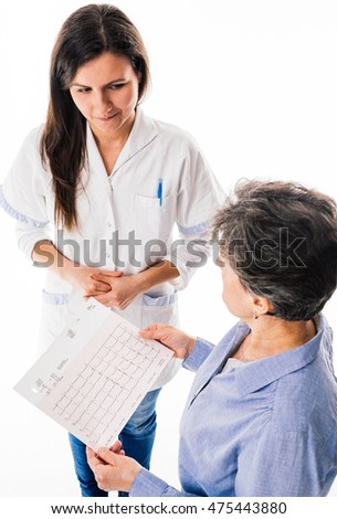 Doctor showing a ECG heartbeat  chart to her  patient