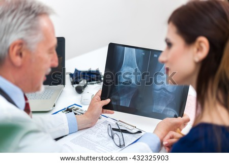 Doctor showing a radiography to his patient