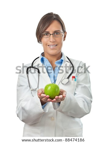 Doctor Showing an apple with both hands as a perfect healthy eating example - stock photo