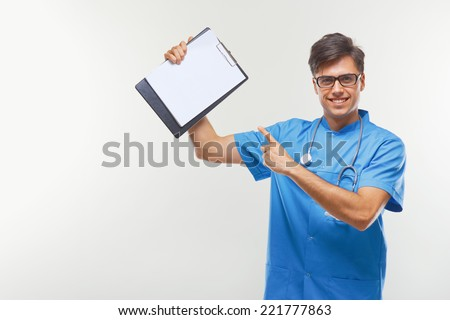 Doctor Showing Clipboard Over White Background