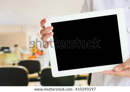 doctor showing tablet computer in the hospital