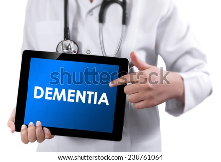 Doctor showing tablet with DEMENTIA text.  - stock photo