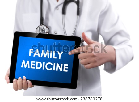 Doctor showing tablet with FAMILY MEDICINE text.  - stock photo