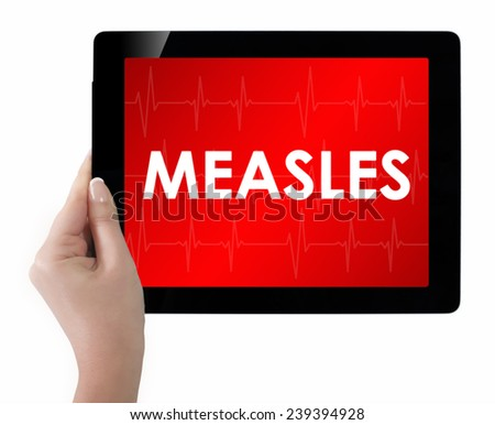Doctor showing tablet with MEASLES text.  - stock photo