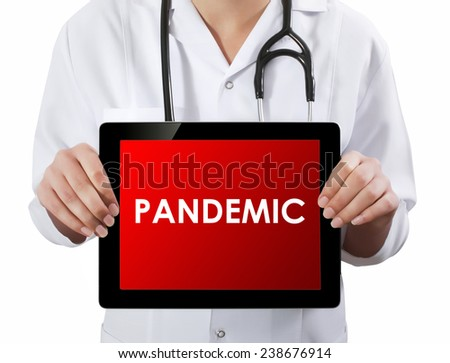 Doctor showing tablet with PANDEMIC text.  - stock photo