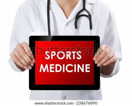 Doctor showing tablet with SPORTS MEDICINE text.  - stock photo