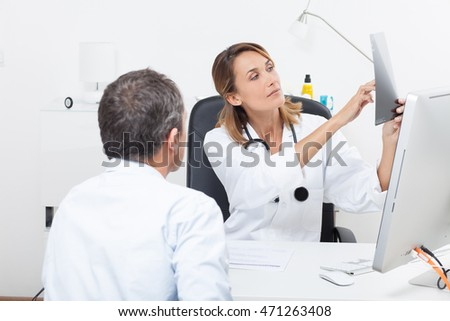 doctor showing the results of an x-ray