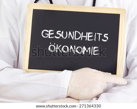 Doctor shows information: health economics in german - stock photo